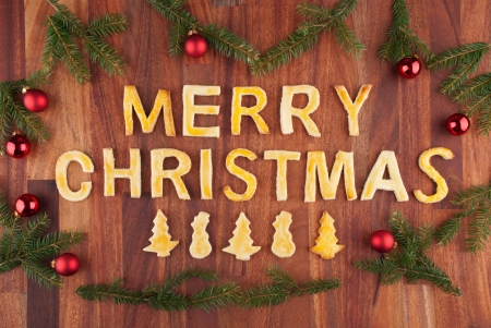 the words merry christmas made with cookies and christmas decorations photo