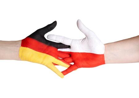 handshake symbolizing partnership between germany and poland photo