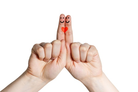 two smiling fingers with a heart, symbolizing relation, love Stok Fotoğraf