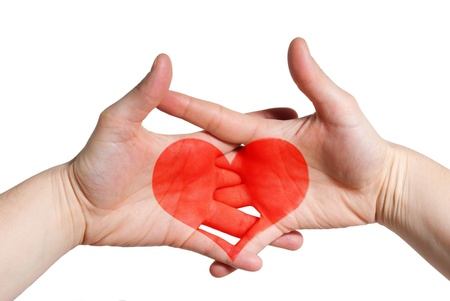 two hands holding each other with a heart in between, symbolizing love and relationship photo