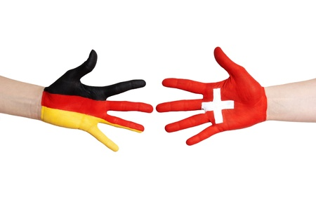 german swiss: two painted hands with swiss and german symbols, isolated Stock Photo