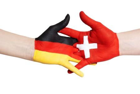 turism: german and swiss partnership, handshake, isolated