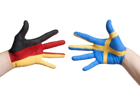 symbolized: germany and sweden flag symbolized with painted hands, isolated Stock Photo