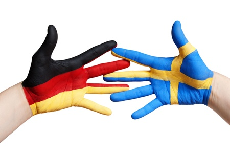 turism: swedish and german painted hands, isolated