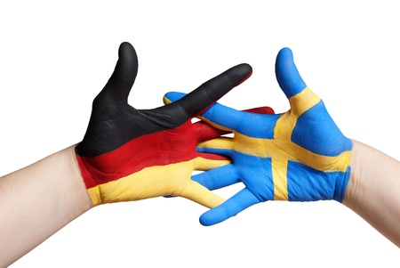 sweden flag: a swedish and a german painted hand, isolated Stock Photo