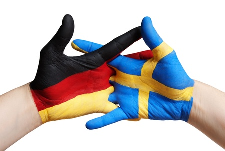 a german and a swedish painted hand, isolated photo