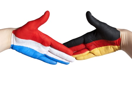 a dutch and german handshake, isolated photo