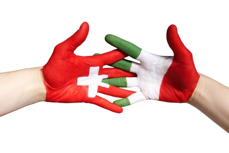 swiss italian partnership with colors painted on hands, isolated photo