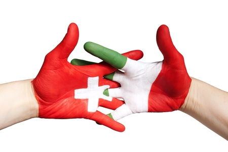switzerland and italy in partnership symbolized with painted hands photo