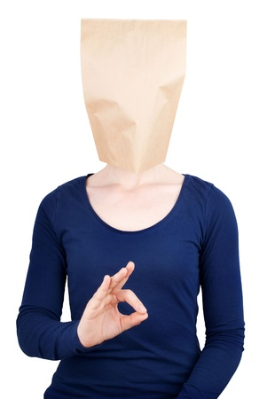 emptiness: a person with a blank paper bag head with copy space showing an okay sign