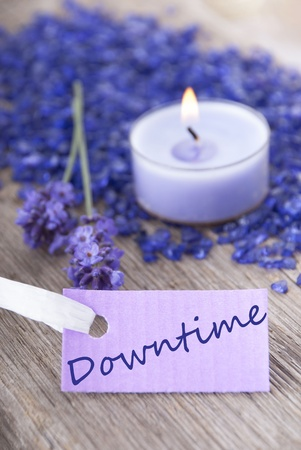 downtime: a purple label on which stands downtime with a recreational background