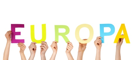 many hands holding the german word Europa which means europe, isolated photo