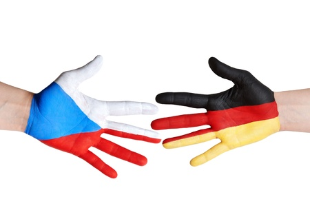 czech republic and germany symbolized with hands photo