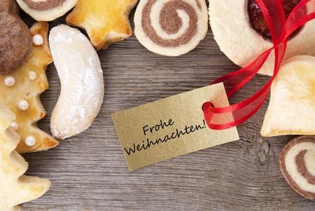 weihnachten: a christmas cookie background with the german words Frohe Weihnachten which means merry christmas