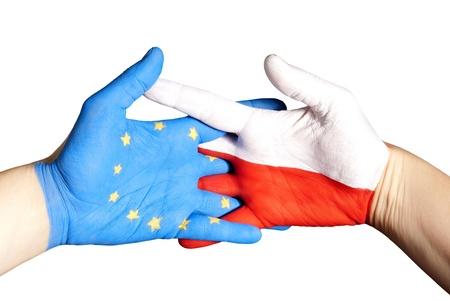 hands symbolizing partnership between poland and europe photo