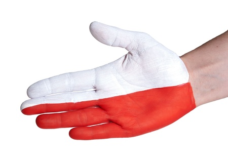 a hand with the polish flag painted on it photo