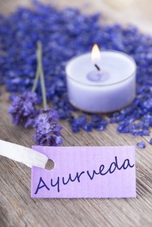 healthfulness: the word Ayurveda on a purple label as wellness background Stock Photo