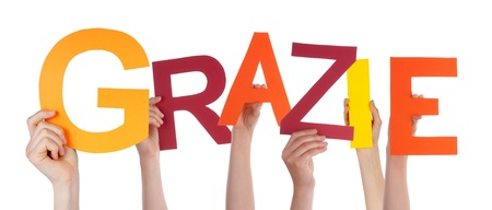 many thanks: Many Hands Holding the Italian Word Grazie Which Means Thanks, Isolated