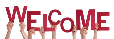 warm welcome: Many Hands Holding a Red Welcome in Their Hands, Isolated Stock Photo