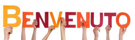bienvenido: Many Hands Holding the Italian Word Benvenuto, Which Means Welcome, Isolated Stock Photo