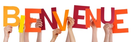 bienvenido: Many Persons Holding the Colorful French Word Bienvenue Which Means Welcome, Isolated
