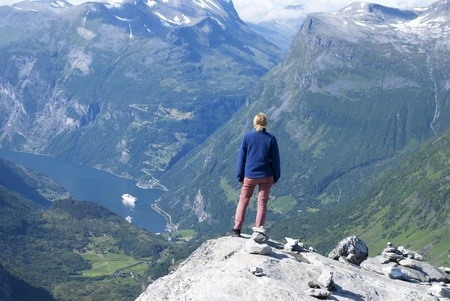panoramatic: A Woman Enjoying a Panoramatic View Over Geiranger Fjord in Norway