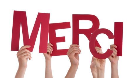 merci: Many Persons Holding the Red French Word Merci, Which Means Thanks, Isolated