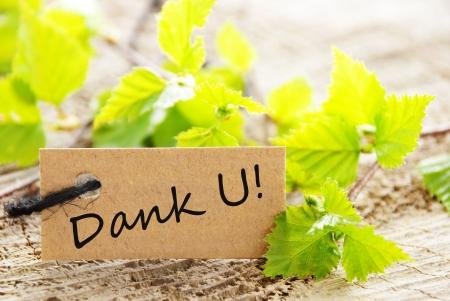 agradecimiento: A Label Buscando Natural con la palabra holandesa que significa Dank U Gracias
