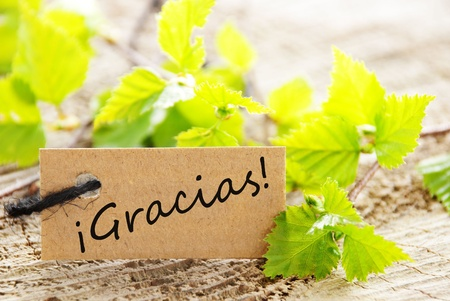 thankfulness: A Label With the Spanish Word Gracias Which Means Thanks