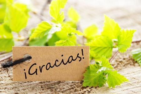agradecimiento: Una etiqueta con la palabra espa�ola que significa Gracias Gracias