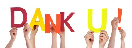 dank: People Holding the Dutch Word Dank U Which Means Thanks, Isolated