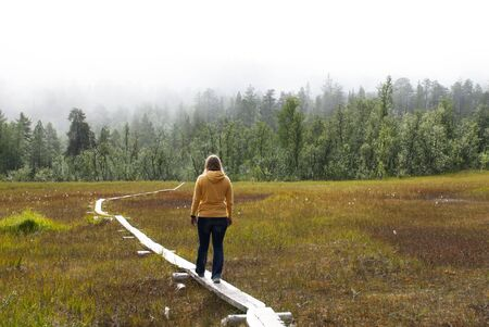 lonelyness: A Woman Walking Lonely on a Path over a Moor