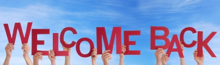 welcome home: Many People Holding a Red Welcome Back in the Sky