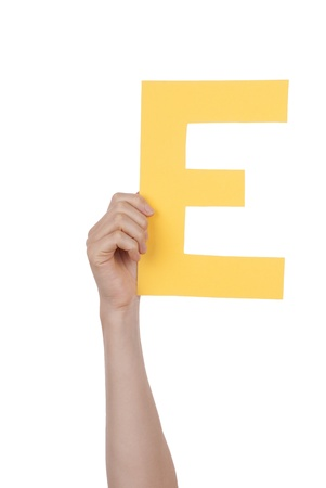 illiterate: A Hand Holds a Yellow E, Isolated Stock Photo