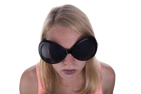 miffed: A Young Blond Teen With Huge Sunglasses Sulking, Isolated