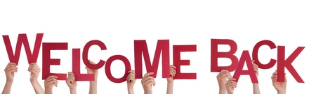 welcome home: Many Hands Holding a Red Welcome Back, Isolated Stock Photo