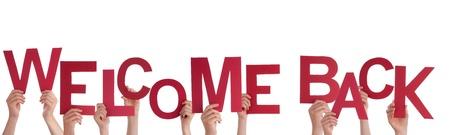 vítejte: Mnoho Ruce drží červené Welcome Back, izolované