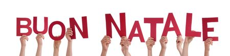 buon: Hands Holding the Italian Word Buon Natale Which Means Merry Christmas, Isolated