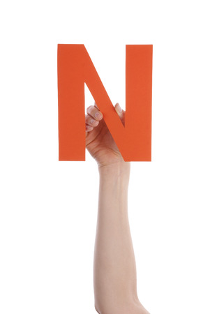 illiterate: A Hand Holds a Orange N, Isolated