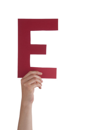 illiterate: A Hand With The Red Character E, Isolated Stock Photo