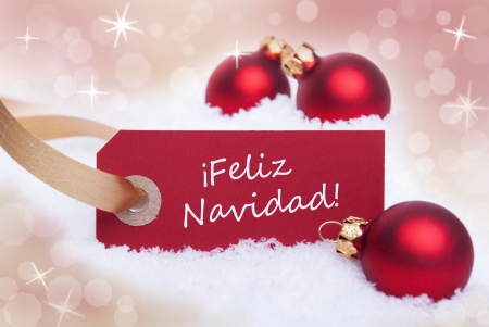 A Red Christmas Label with the Spanish Words Feliz Navidad Which Means Merry Christmas