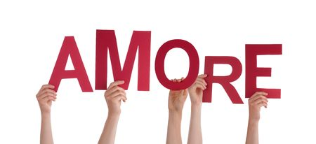 amore: Many Hands Holding the Italian Word Amore Which Means Love, with Red Letters, Isolated