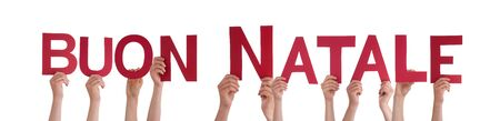 buon: Many People Holding the Italian Word Buon Natale Which Means Merry Christmas, Isolated