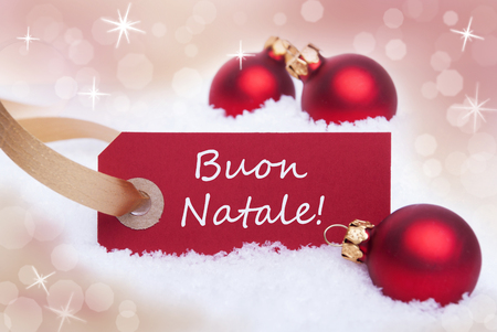 A Red Label With the Italian Words Buon Natale Which Means Merry Christmas photo
