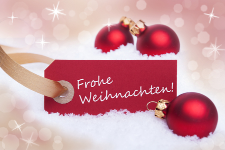 weihnachten: A Red Label With the German Words Frohe Weihnachten Which Means Merry Christmas Stock Photo