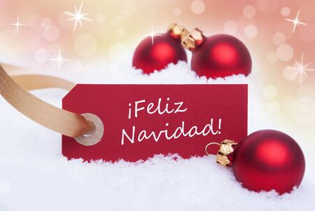 A Red Tag With the Spanish Words Feliz Navidad Which Means Merry Christmas on It photo