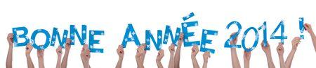 turns of the year: Muchas Manos que sostienen las Palabras francesas Bonne Ann�e 2014 �Qu� significa Feliz A�o Nuevo 2014, aislado