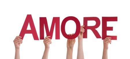 amore: Many People Holding the Italian Word Amore Which Means Love, with Red Letters, Isolated