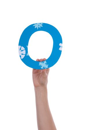 illiterate: A Hand Holding the Blue and Snowy Letter O, Isolated