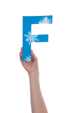 A Hand Holding a F with Snowflakes, Isolated